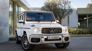 2019 Mercedes-AMG G63: Everything You Need To Know About The ... Future Truck Rendering 2016 Mercedesbenz G63 Amg Black Series This Gclass Wants To Become A Monster Aoevolution Deep Dive 2019 Glb Crossover Automobile Mercedes Gclass 2018 Pictures Specs And Info Car Magazine 1983 By Thetransportguild On Deviantart Gwagen Savini Wheels Vs Land Rover Defender Youtube Inspiration 6x6 Drive Review Autoweek