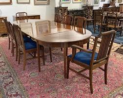 A Mahogany Three Piece Dining Table,