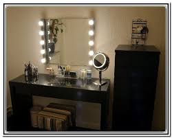 the light bulb makeup vanity mirror with bulbs around it in for