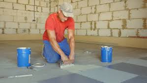 laying rubber floor tiles stock footage 30624997