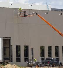 100 Mclane Trucking Projects Underway Include 12screen Theater Distribution Center