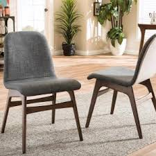 baxton studio embrace gray fabric upholstered dining chairs set