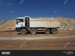 White Dump Truck, Lorry Stones Sand Image & Photo | Bigstock Truck Stones On Sand Cstruction Site Stock Photo 626998397 Fileplastic Toy Truck And Pail In Sandjpg Wikimedia Commons Delivering Sand Vector Image 1355223 Stockunlimited 2015 Chevrolet Colorado Redefines Playing The Guthrie News Page Select Gravel Coyville Texas Proview Tipping Stock Photo Of Vertical Color 33025362 China Tipper Shacman Mini Dump For Sale Photos Rock Delivery Molteni Trucking Why Trump Tower Is Surrounded By Dump Trucks Filled With Large Kids 24 Loader Children