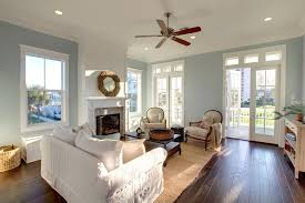 traditional living room with ceiling fan crown molding zillow