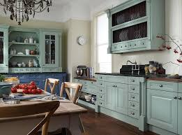 Sea Blue Kitchen Island Combined With White Cabinet