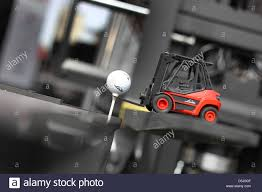 100 Toy Forklift Truck A Contestant Tries Pick Up A Golf Ball With A Toy Forklift Truck