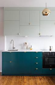 Chic Teal Cabinets With Gold Handles Make A Cool Statement