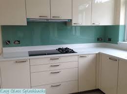 Splash Guard Kitchen Sink by Mint Green Coloured Glass Splashback In A White Kitchen With White