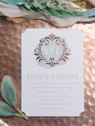 Blue And White Watercolor Invitations On A Rose Gold Backdrop With Leaves
