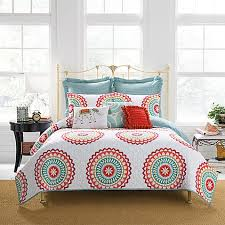 Anthology™ Bungalow Reversible Quilt in Coral White Bed Bath