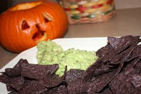 Picture Of Pumpkin Throwing Up Guacamole by Halloween Party