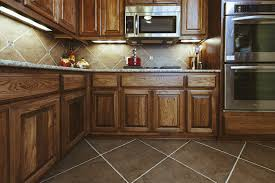 best beige tile flooring for rustic kitchen with wooden cabinet