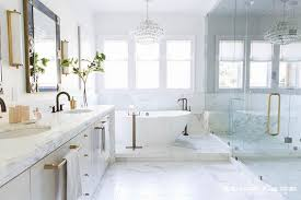 Chandelier Over Bathroom Vanity by Gold Cage Chandelier Over Oval Bathtub Transitional Bathroom