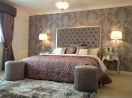 A Bedroom In Shades Of Grey And Brown With Warm Lighting
