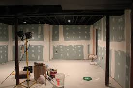 Using A Paint Sprayer For Ceilings by Basement Remodel With Painted Exposed Ceiling