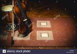 Tiled Carpet by Violin And Percussion Instruments On Tiled Carpet European And