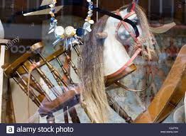 Old Fashioned Rocking Horse In A Toy Shop Window