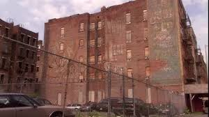 A Run Down Apartment Building Overlooks Fenced Stock Footage From Discovery Access