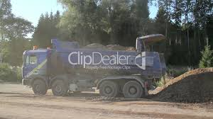 A Dump Truck Unloading Sand And Soil; House: Royalty-free Video And ...