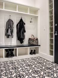 alexandra kaehler design mudroom with painted cement tile floor