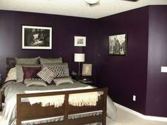 Deep Purple Bedrooms by Deep Purple Bedroom Wall Color With Silver Chrome Accents For