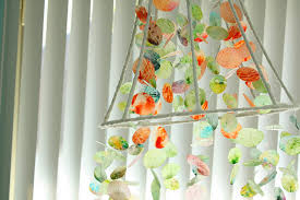 Make Wax Paper Shapes And Then Hang Them From A Fabric Wrapped Lamp Shade Skeleton