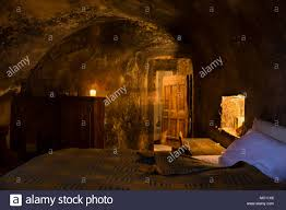100 Sextantio Cavelike Medieval Guest Room With Lit Candles Massive Wooden Doors