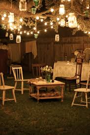 Rustic Party Decorations Summer Outdoor With Hanging Lighting On Trees And Small Wooden Wine Table