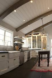 exposed beam ceiling lighting kitchen rustic with glass front