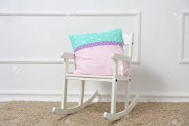 Pillow Rests On A Rocking Chair In The Children's Room. Front Lowes Folding Nursery Glider Acacia Rocking Child Gripper Jumbo Chair Cushions Nouveau Walmartcom White Wooden Childrens Rocking Chair Princes Ponies And Diamonds Childrens Bedroom Enjoying Fniture Completed With Unfinished Wood Toddler Magnificent Aldi Couches Ottoman Brown Office Child In E1 Hamlets For 1500 Sale Shpock Ikea Modern Decoration Delta Children Blair Slim Swivel Rocker Taupe Hoohobbers Innovations