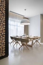 Skygarden Takes Center Stage In This Minimalist Dining Room With Light Wood Settings And Large Windows