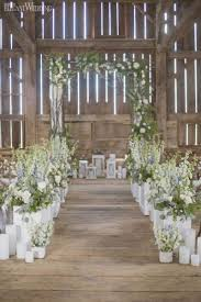 Rustic Wedding Ceremony With Greenery Arch