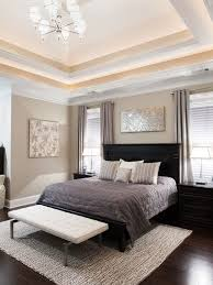 Transitional Bedroom With Light Brown Wall Paint Color Also Black Modern Bed Divan And Gray