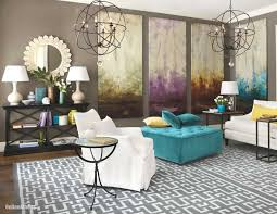 Living Room Decor Idea With White Fabric Couch And Accent Chair Also Teal Ottoman Under 2 Antique Chandeliers Artistic Wall Mirror Above Black Cabinet