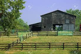 Horse Barn - An Old Rustic Barn For Horses Sits At The Back Of ... Buildings Barns Inc Horse Barn Cstruction Contractors In 10x20 Rustic Unpainted Animal Shelters Architectural Images Interior Design Photos Extraordinary Pictures Of Houses Decorating Ideas Deewmcom Traditional Wood Great Plains Western Project Small Ideas Webbkyrkancom Wedding Event Sand Creek Post Beam Custom Timber Frame Snohomish Washington Easily Make It 46x60 Great Plains Western Horse Barn Predesigned House Plan Michigan Pole Metal Morton Backyard Patio Wondrous With Living Quarters And