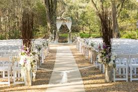 Outdoor Rustic Wedding Ceremony Decor With Tall Purple And Ivory Floral Aisle Decorations