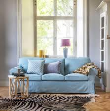 baby blue light blue sofa with a faux zebra skin rug vintage