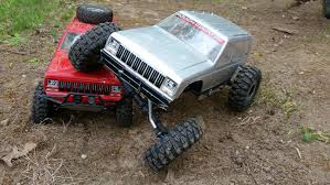 Two RC Jeep Cherokee XJ Rock Crawler 4x4 Trucks Axial SCX10 Honcho ... Rc Rock Crawler Car 24g 4ch 4wd My Perfect Needs Two Jeep Cherokee Xj 4x4 Trucks Axial Scx10 Honcho Truck With 4 Wheel Steering 110 Scale Komodo Rtr 19 W24ghz Radio By Gmade Rock Crawler Monster Truck 110th 24ghz Digital Proportion Toykart Remote Controlled Monster Four Wheel Control Climbing Nitro Rc Buy How To Get Into Hobby Driving Crawlers Tested Hsp 1302ws18099 Silver At Warehouse 18 T2 4x4 1 Virhuck 132 2wd Mini For Kids 24ghz Offroad 110th Gmc Top Kick Dually 22