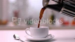 Coffee Being Poured From Cafetiere Into Cup In Kitchen