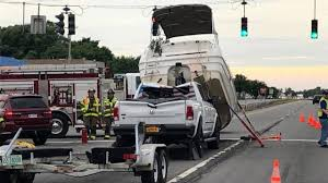 100 Truck Boat Breaks Free Crashes Onto Truck Towing It Officials Say WSBTV