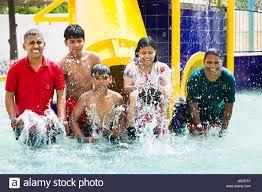 Happy Indian Family Bathing Waterpark Swimming Pool Having Fun Enjoy