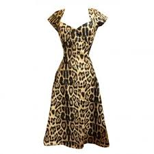 This Wonderfully Lovely Leopard Print Dress Features Cap Sleeves A Very 1950s Inspired Neckline Fitted Seaming Through The Bodice And Swingy Line