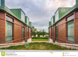 100 Three Storey Houses View Of Green Lawn Between Walls And Windows Of Storey