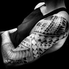 Polynesian Tribal Sleeve Tattoo Design Of A Warrior With Spearheads That Represent Courage And Healthy Agression
