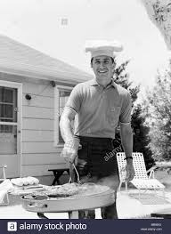 1960s SMILING MAN OUTDOORS IN BACKYARD PATIO WEARING CHEF HAT ... My Baby Klose Backyard Chef Jr Bbq Watch Video Entpreneur Endeavors Johnstown Chef Seeks 1960s Smiling Man Outdoors In Backyard Patio Wearing Chef Hat Barbecue With The Bearded Youtube Must Haves For The Thebabyspotca Movie Theater Screens Refuge Amazoncom Bake And Grill Master Mat Baking Copper Ideas Collection Gas Bbq Stainless Lid Be E Best Your Hero Steak