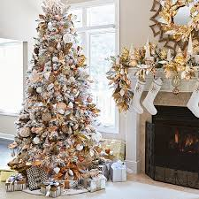 Artificial Flocked Christmas Tree Decorated With Metallic Copper Silver Gold And Pink Mercury Glass