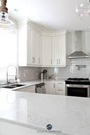 low contrast white kitchen with bianco drift quartz countertops