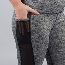 Hand In A Sheer Pocket Panel Of Gray Leggings