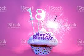 Happy 18th Birthday Cupcake with Candle and Sparkler royalty free stock photo