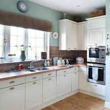 Relaxed Nautical Style Kitchen The Brown Wall Tiles Create Perfect Contrast With White Units In This Touches